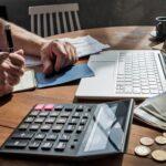 Man man checking home finance calculating money.
